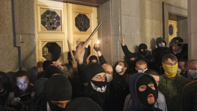 Right Sector movement activists and supporters gather outside the parliament building to demand the resignation of Internal Minister Arsen Avakov, in Kiev
