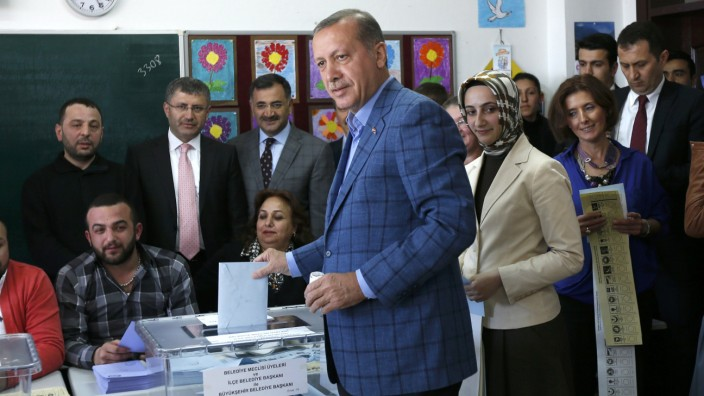 Turkey's Prime Minister Erdogan casts his ballot at a polling station during the municipal elections in Istanbul
