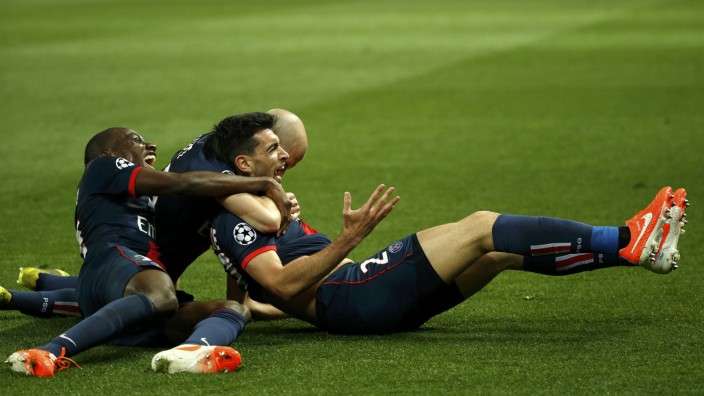 Paris St Germain's Patore celebrates with team mates after scoring the third goal for the team during their Champions League quarter-final first leg soccer match against Chelsea at the Parc des Princes Stadium in Paris