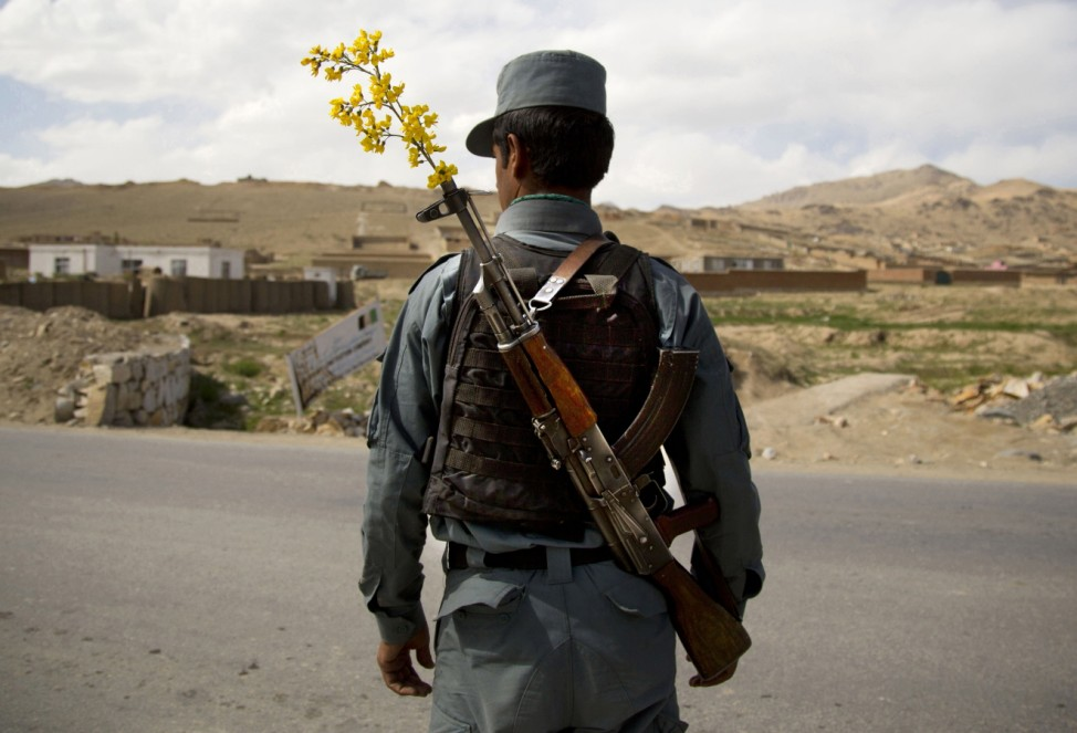 FILE - In this May 15, 2013 file photo, an Afghan National Police officer...