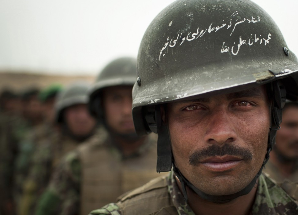 In this Wednesday, May 16, 2012 photo, Afghan National Army soldier Mohammed...