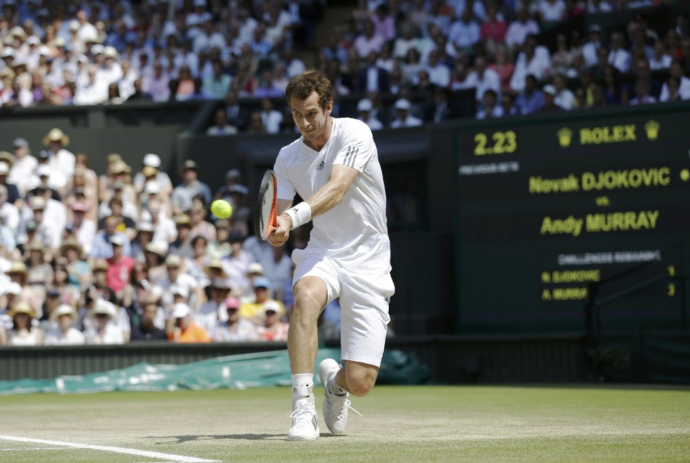 Andy Murray of Britain hits a return to Novak Djokovic of Serbia during their men's singles final tennis match at the Wimbledon Tennis Championships, in London