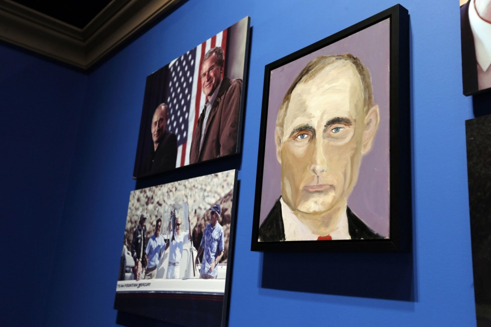 A portrait of Russian President Vladimir Putin, painted by former U.S. President George W. Bush, is displayed at 'The Art of Leadership: A President's Personal Diplomacy' exhibit in Dallas