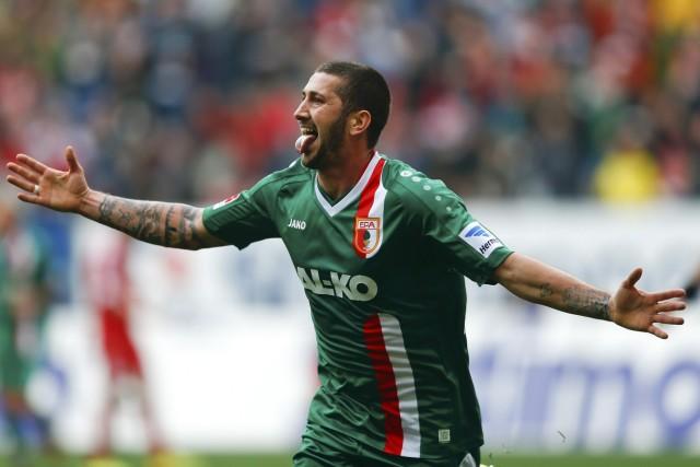 Augsburg's Moelders celebrates after he scored against Bayern Munich during their Bundesliga soccer match in Augsburg
