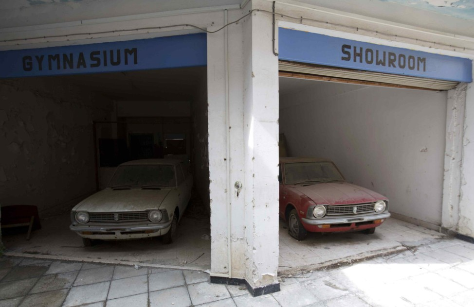 Cars sit abandoned in a former shopping centre in the United Nations buffer zone in central Nicosia
