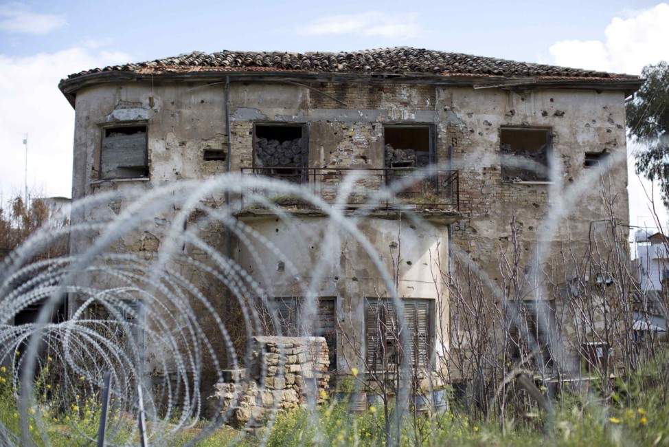 A former residential property stands abandoned in the United Nations buffer zone in central Nicosia
