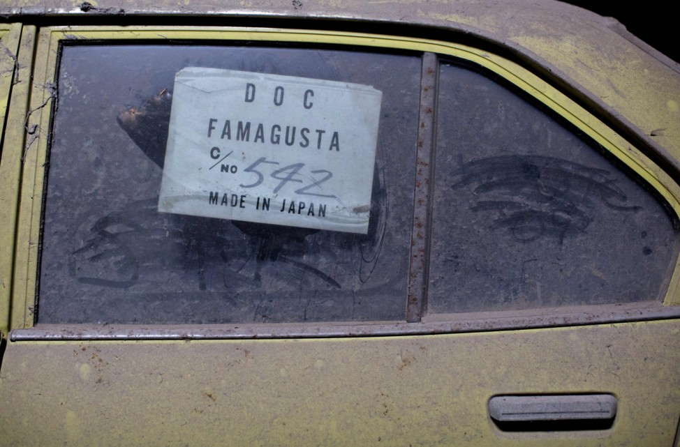 An import sticker is seen on the window of a car in the United Nations buffer zone in central Nicosia
