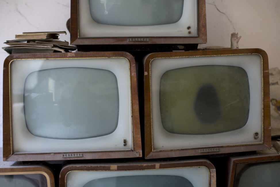 Old televisions found and collected by soldiers are seen in an abandoned commercial area in the United Nations buffer zone in central Nicosia