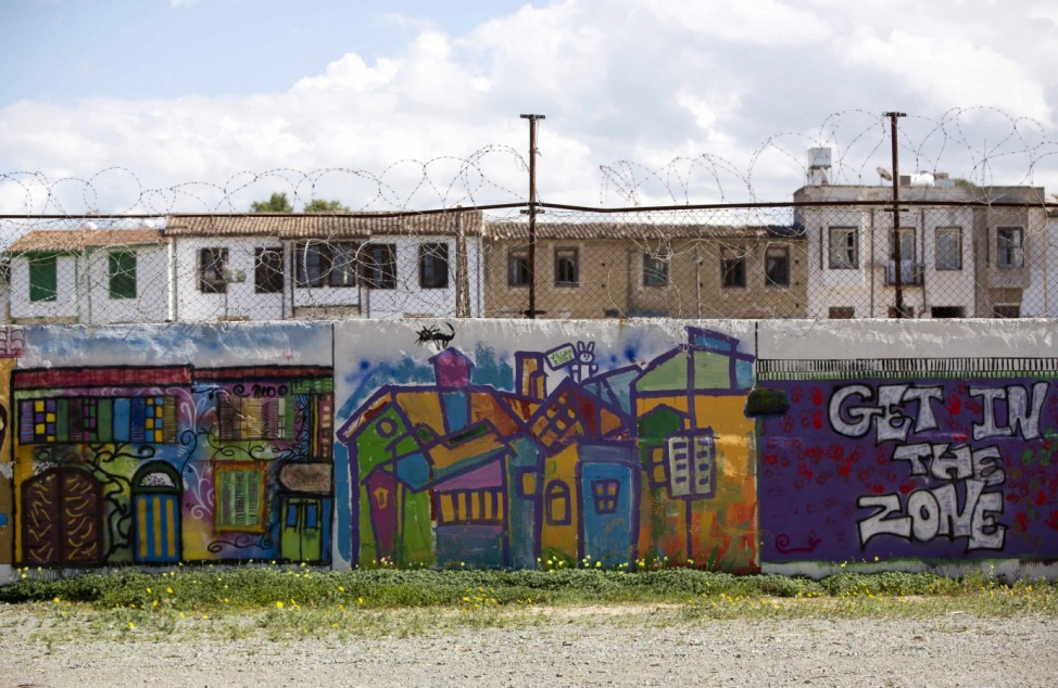 A wall marking the boundary of the United Nations buffer zone is seen from the Greek Cypriot-controlled area of central Nicosia