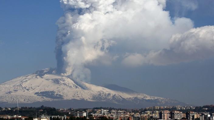 Mount Etna spews volcanic ash during an eruption in Sicily