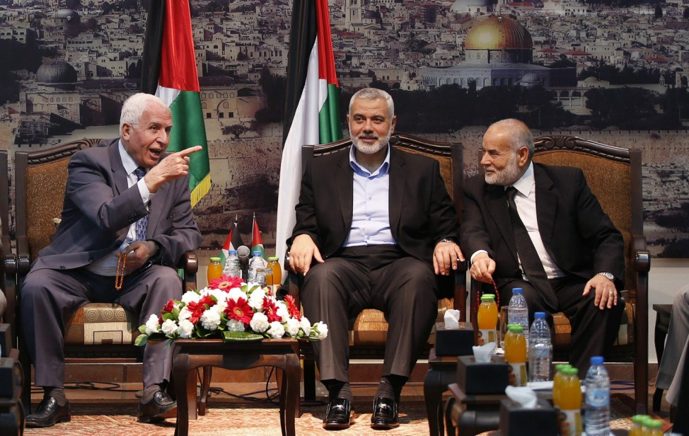 Al-Ahmed, a senior Fatah official and head of the Hamas government Haniyeh and deputy speaker of Palestinian Parliament Bahar attend a meeting in Gaza City