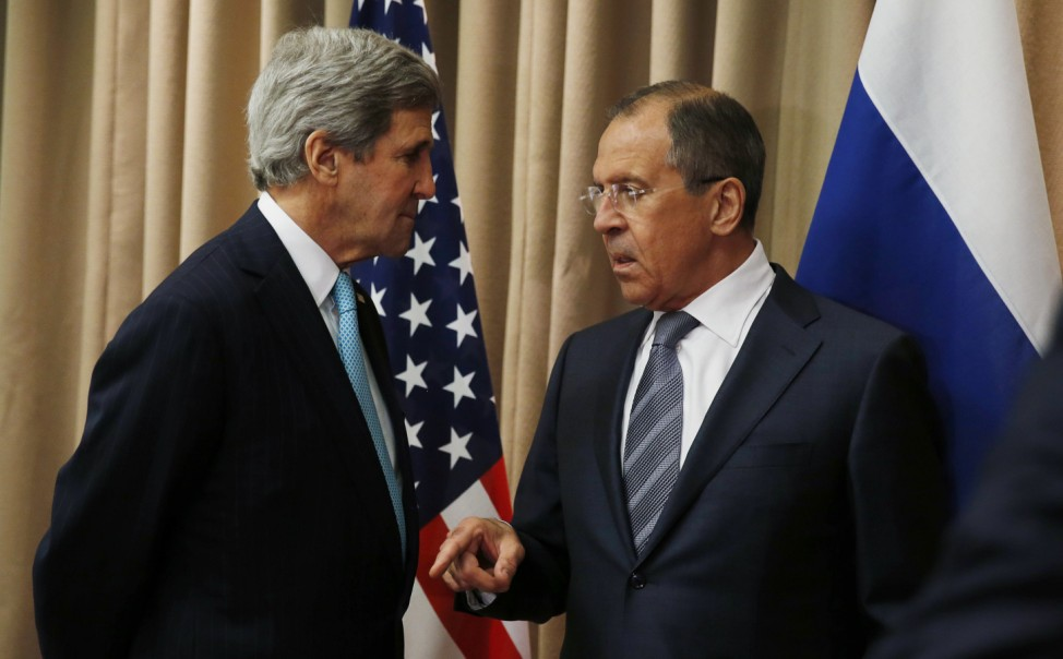 U.S. Secretary of State Kerry talks with Russia's Foreign Minister Sergei Lavrov at the start of a bilateral meeting in Geneva