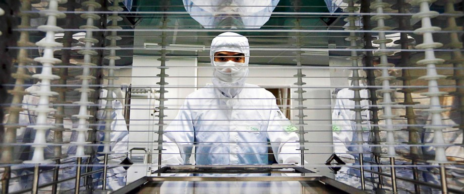 An employee works inside an electronic products factory in Huzhou