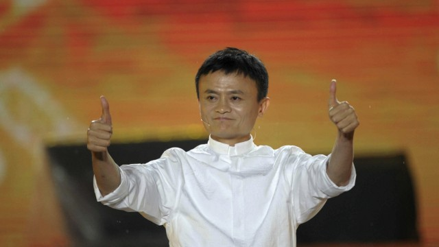 File photo of Alibaba founder Ma gesturing during celebration of 10th anniversary of Taobao Marketplace in Hangzhou