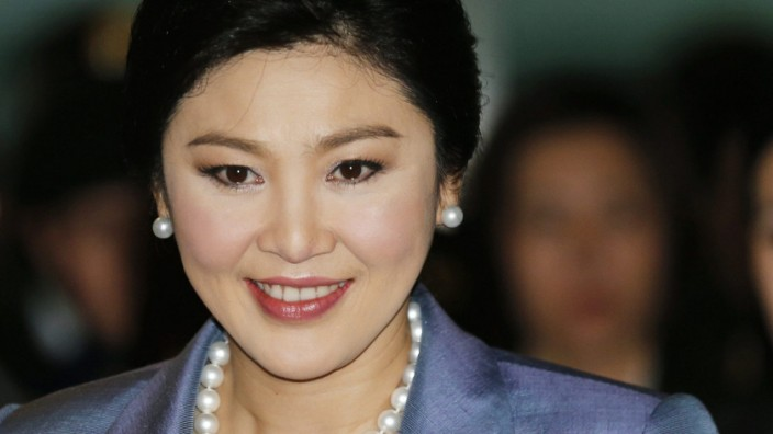 Thai caretaker Prime Minister Yingluck Shinawatra on defence in a