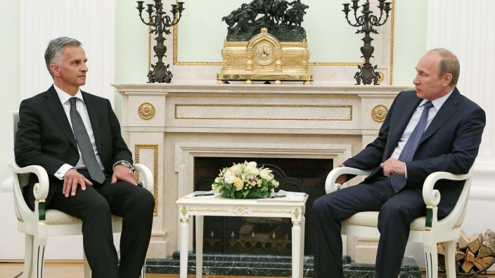 Russian President Vladimir Putin meets with Swiss President and Foreign Minister Didier Burkhalter at the Kremlin in Moscow