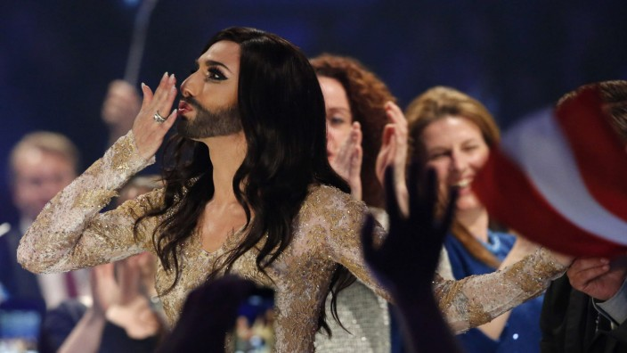 Conchita Wurst representing Austria reacts after qualifying in the second semi-final at the 59th annual Eurovision Song Contest at the B&W Hallerne in Copenhagen