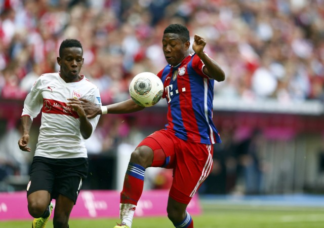 Bayern Munich's Alaba and VfB Stuttgart's Traore fight for the ball in German first division Bundesliga soccer match in Munich
