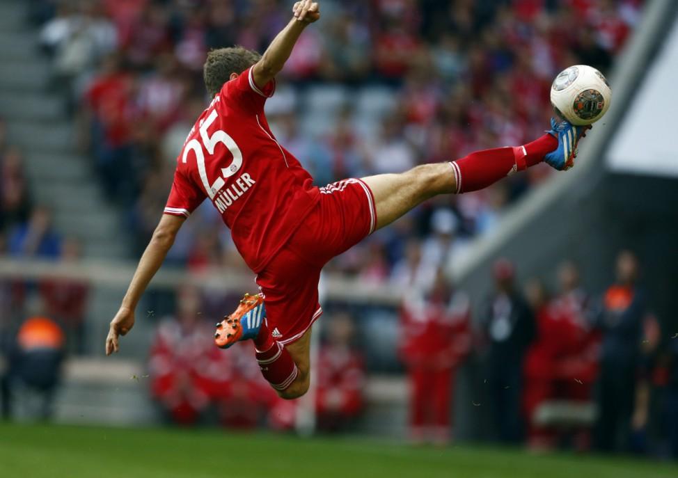Mueller of FC Bayern Munich tries to score during their German first division Bundesliga soccer match against Hertha Berlin in Munich
