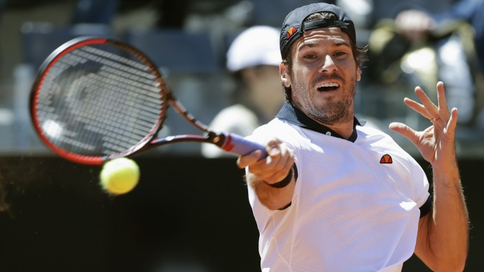 Haas of Germany hits a return to Wawrinka of Switzerland during their men's singles match at the Rome Masters tennis tournament