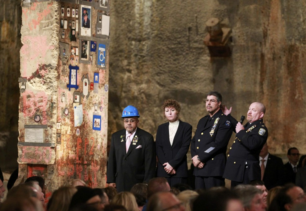 First responders Manny Rodriguez, Pia Hofmann, Det. Anthony Favara, of the NYPD and Lt. Stephen Butler, of the Port Authority Police, speak next to the 'Last Beam' during the dedication ceremony at the National September 11 Memorial Museum in New York