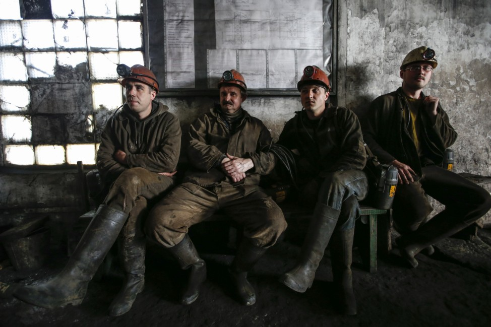 Miners sit at the Gorniak 95 coal mine in the town of Makiyivka, near the regional capital of Donetsk in eastern Ukraine