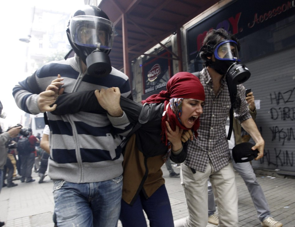 Plain clothes police officers detain a demonstrator during a protest in Istanbul