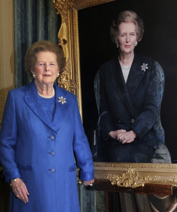 Handout shows former British Prime Minister Thatcher posing next to a portrait of herself