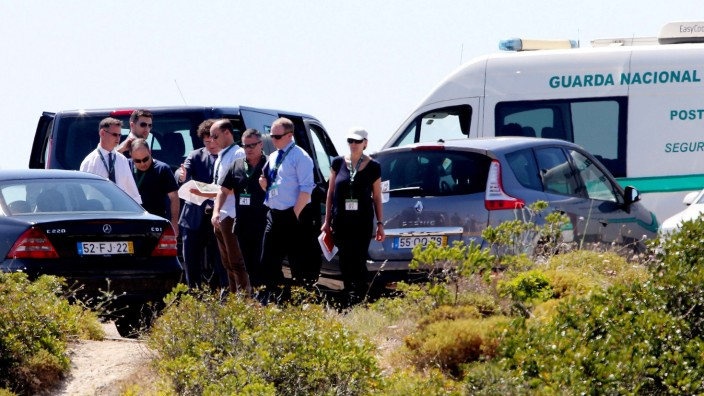 Scotland Yard detectives meet with members of the Portuguese police at an area in Praia da Luz