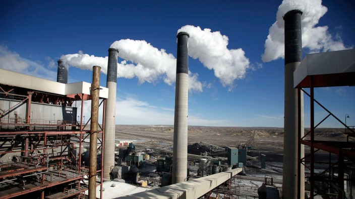 Steam rises from the stacks of the coal fired Jim Bridger Power Plant outside Point of the Rocks, Wyoming