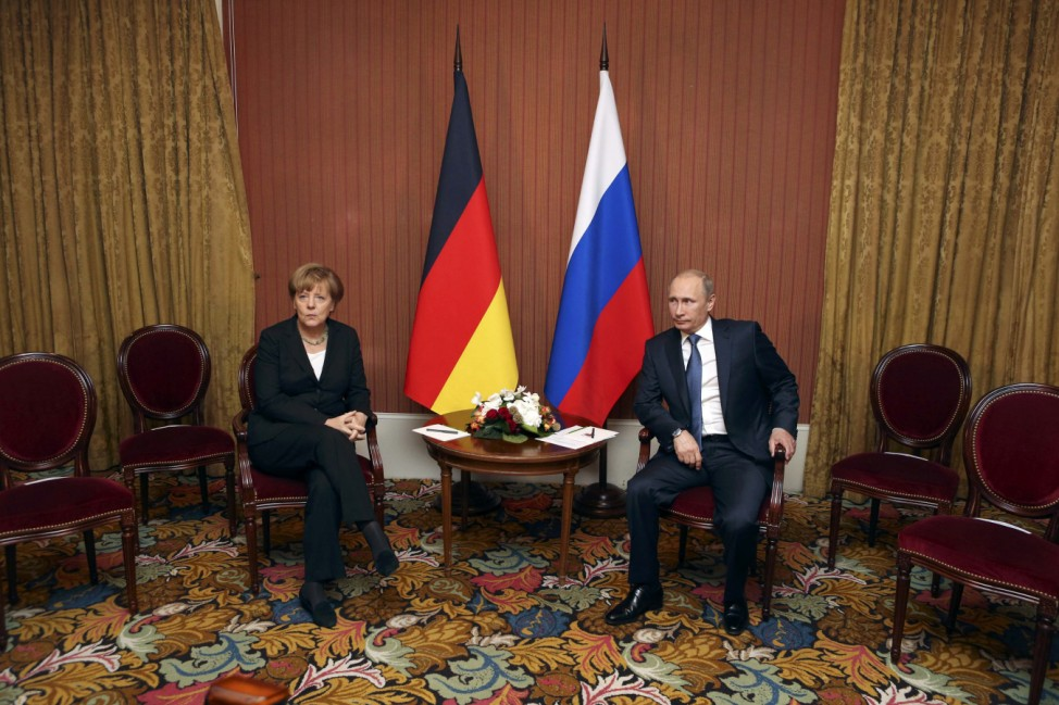 Russian President Putin meets with German Chancellor Merkel in Deauville, Northern France