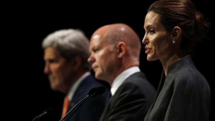 Angelina Jolie, William Hague und John Kerry auf der Konferenz in London