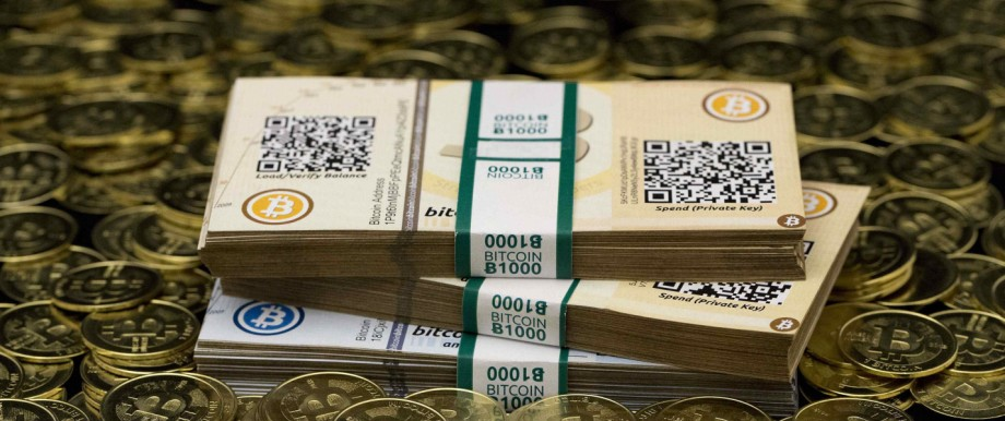 File photo of some of Bitcoin enthusiast Mike Caldwell's coins and paper vouchers in Sandy, Utah