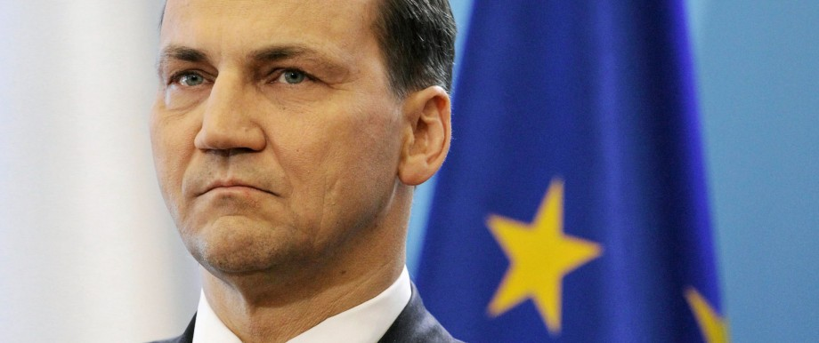 File photo of Polish Foreign Minister Radoslaw Sikorski during a news conference after a government sitting in Warsaw