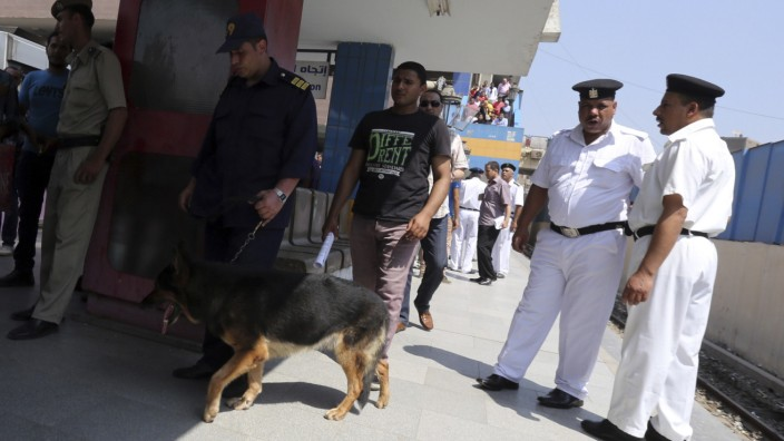 A canine unit inspects the area of a blast in Shubra El-Kheyma metro station in Greater Cairo