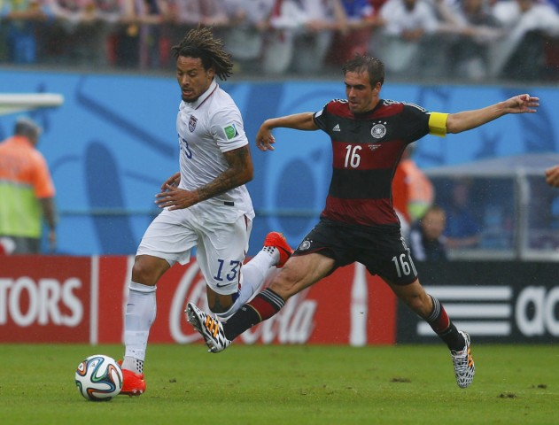 Jones of the U.S. fights for the ball with Germany's Lahm during their 2014 World Cup Group G soccer match at the Pernambuco arena in Recife