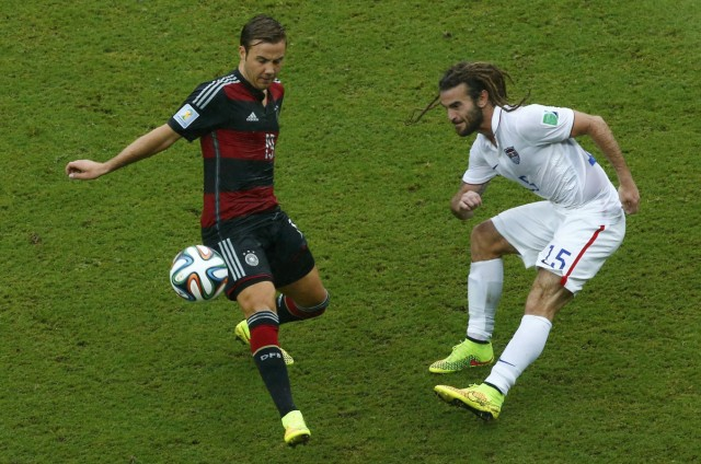 Beckerman of the U.S. and Germany's Goetze fight for the ball during their 2014 World Cup Group G soccer match in Recife