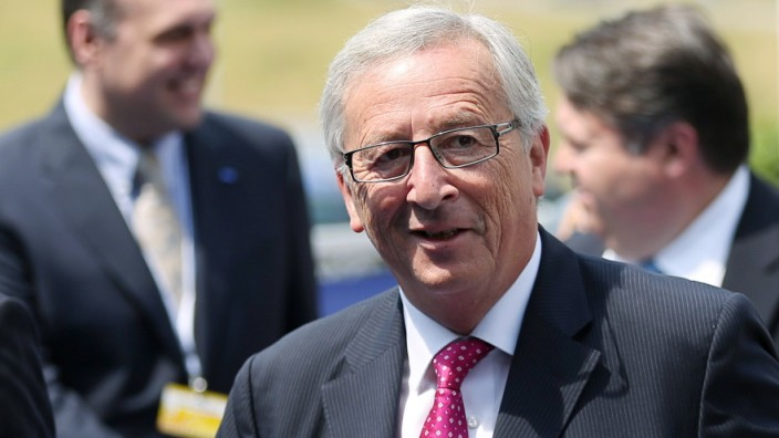 Candidate for the European Commission presidency Juncker arrives at an European People's Party meeting in Kortrijk