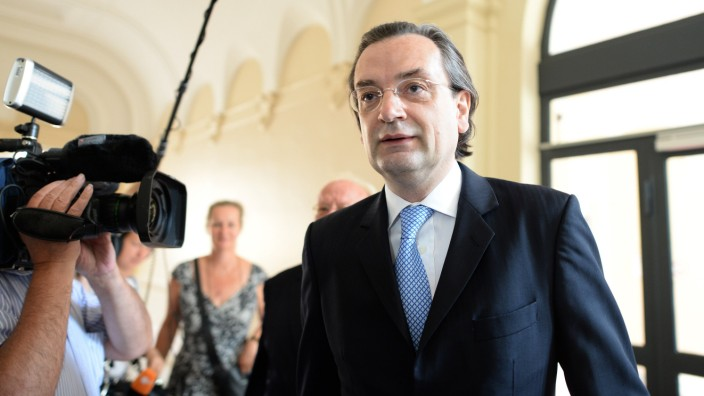 Defendant Nonnenmacher former chief executive of German bank HSH Nordbank enters courtroom of a Hamburg