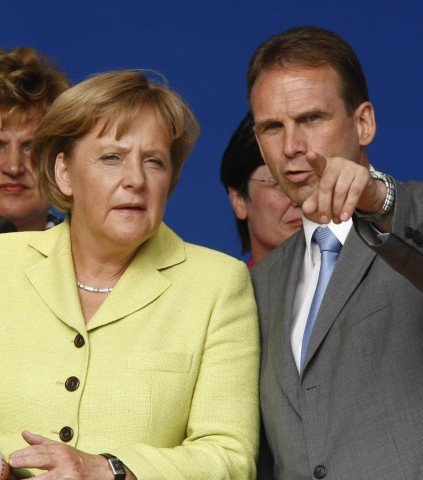 German Chancellor Merkel and Thuringia's federal state Prime Minister Althaus attend an election campaing rally in Erfurt