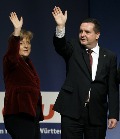 Merkel German Chancellor waves with Stefan Mappus Baden-Wuerttemberg's state premier during a campaigning event in Wiesbaden