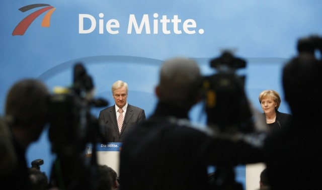 Hamburg's ruling Christian Democratic party mayor von Beust and German Chancellor Merkel address a news conference in Berlin