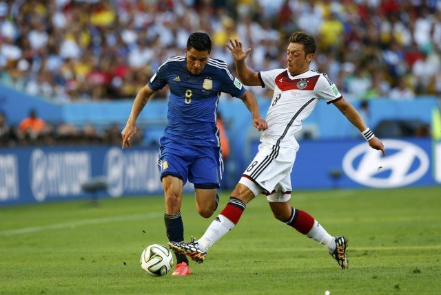 Argentina's Enzo Perez fights for the ball with Germany's Mesut Ozil during their 2014 World Cup final at the Maracana stadium
