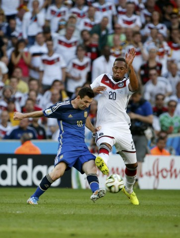 Argentina's Lionel Messi and Germany's Jerome Boateng fight for the ball during their 2014 World Cup final at the Maracana stadium in Rio de Janeiro