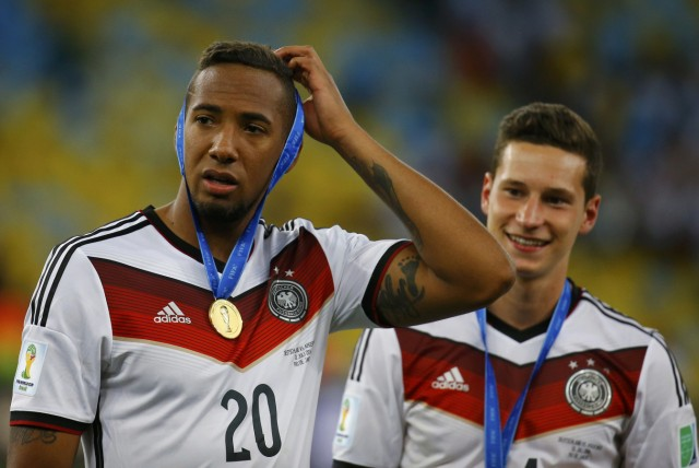 Germany's Boateng and Draxler wear their gold medals after their team won the World Cup trophy at the end of their 2014 World Cup final against Argentina at the Maracana stadium in Rio de Janeiro