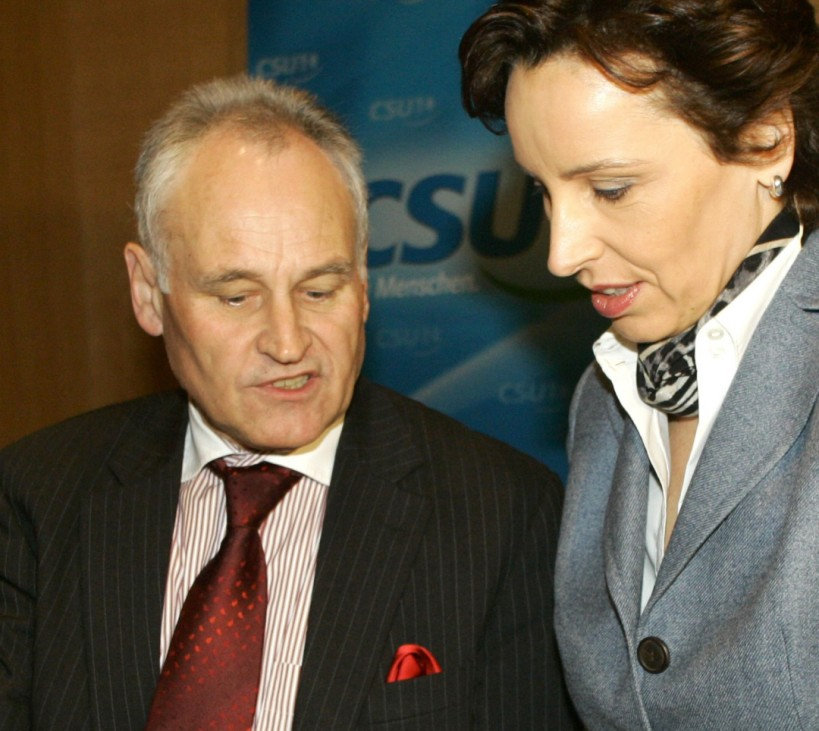 Leader of the CSU Huber talks to Haderthauer, general secretary of the CSU before board meeting in Munich