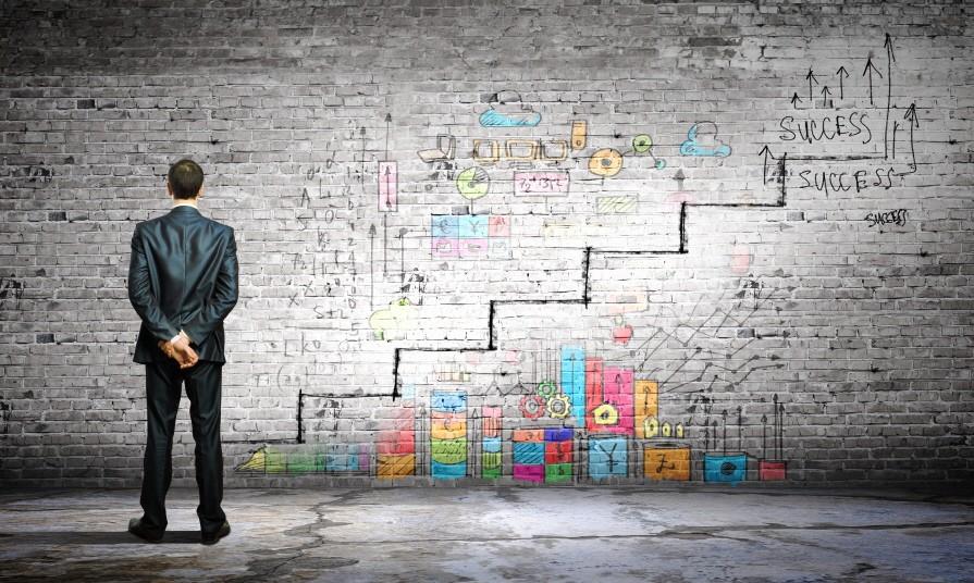 Success ladder; Mann mit Karriereplan