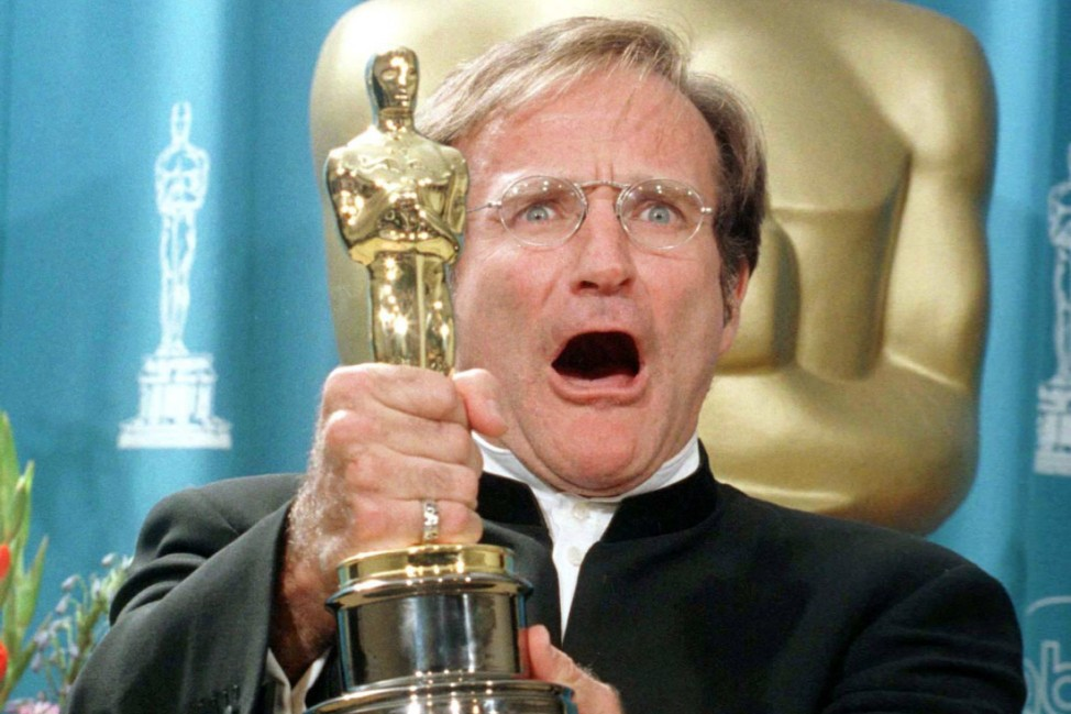 File picture shows Robin Williams holding his Oscar after winning Best Performance by an Actor in a Supporting Role at the 70th Annual Academy Awards