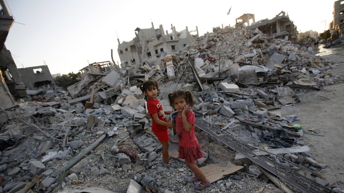 Truce holds in Gaza as warring sides resume talks in Cairo