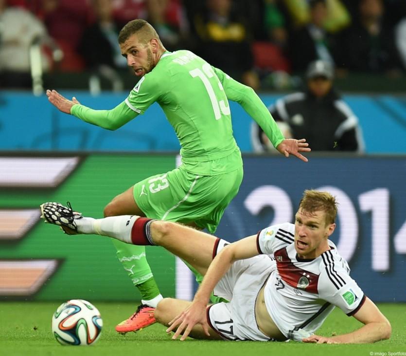 140630 PORTO ALEGRE June 30 2014 Xinhua Algeria s Islam Slimani L vies with Germany s